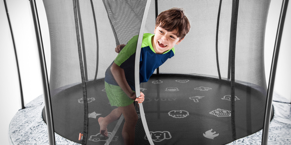 Boy exiting a Vuly trampoline safety net