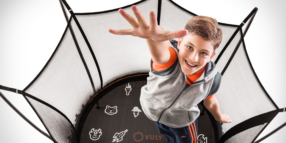 Boy bouncing high on a Vuly Thunder trampoline