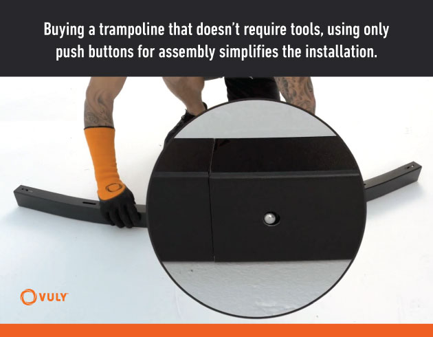 Push buttons being used to connect Vuly trampoline components together