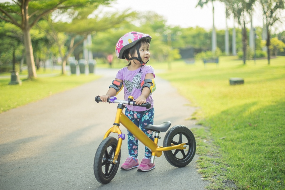 Young child on her balance bike