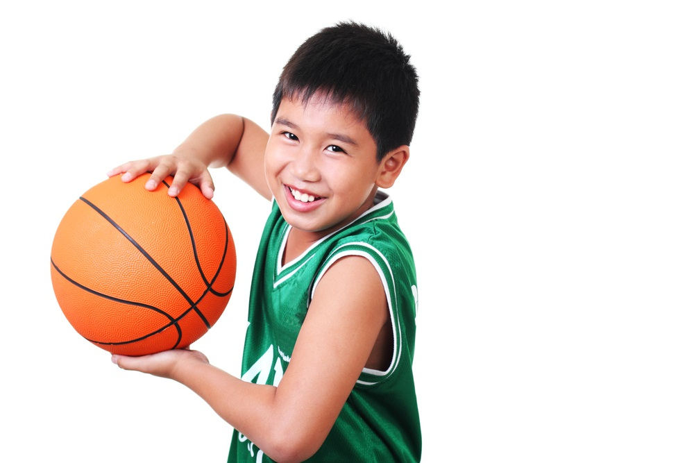 Kid holding basketball