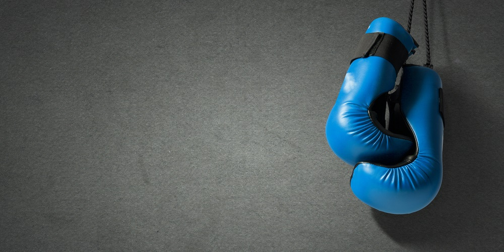 Blue boxing gloves on a black background