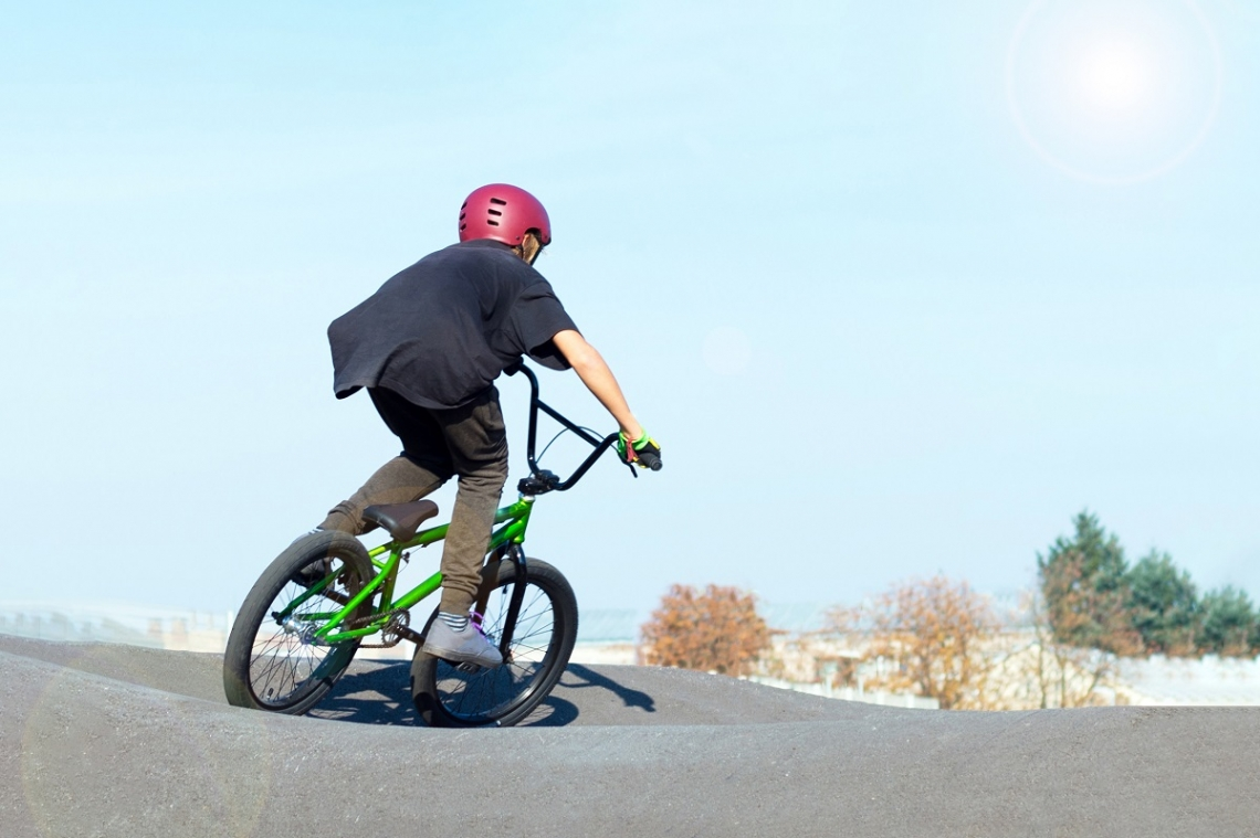 Kid on his BMX bike at a skate park