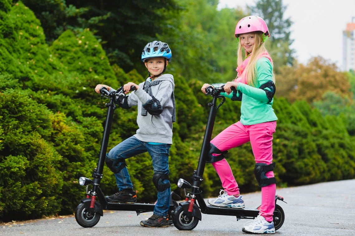 Kids on electric scooters in the city