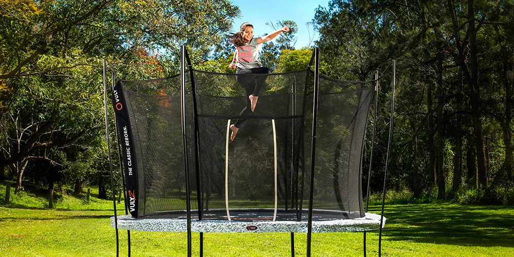 Girl bouncing on a Vuly trampoline while shadow boxing