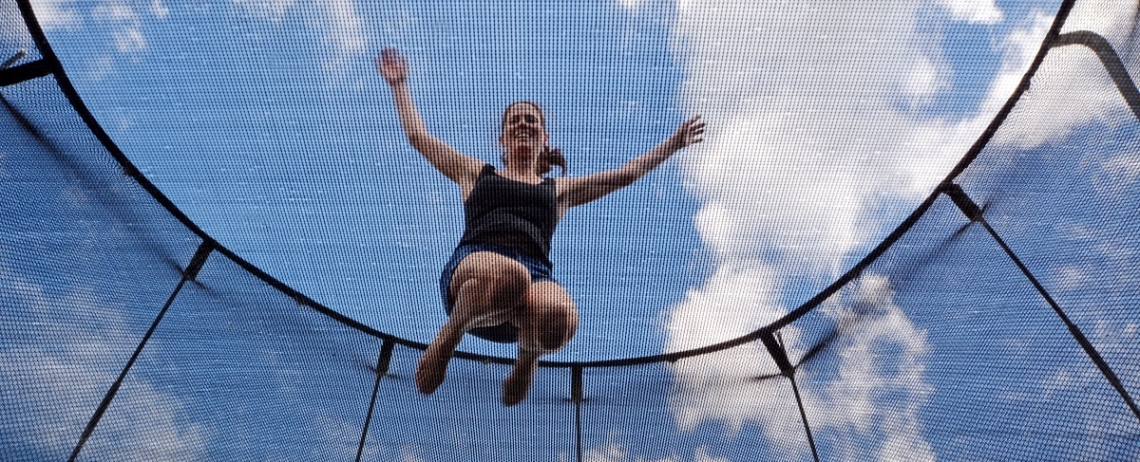 Women bouncing on a trampoline ready for exercise
