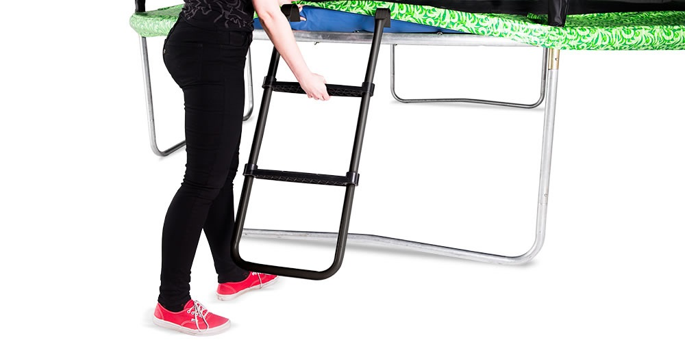 Woman climbing up trampoline safety ladder