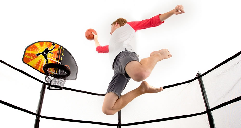 Kid shooting towards Vuly basketball trampoline accessory