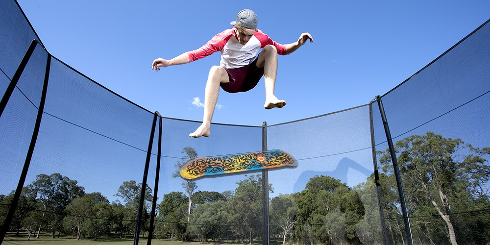 Kid bouncing and doing a trick with a Vuly deck trampoline accessory