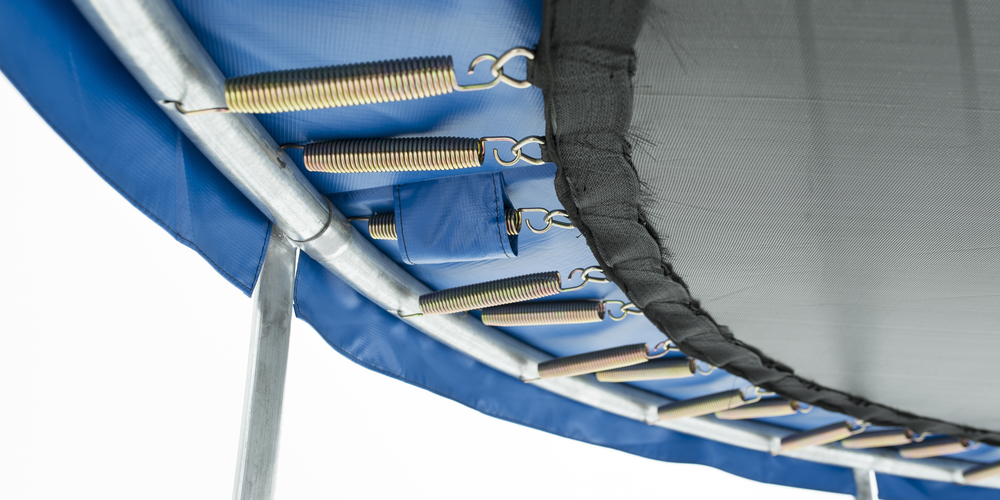 Trampoline safety net showing coiled springs underneath