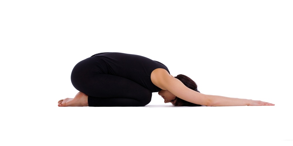 Woman in the child pose yoga position