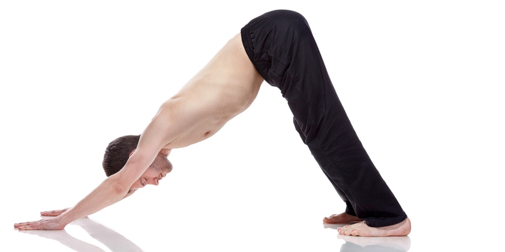 Woman in downward dog pose position