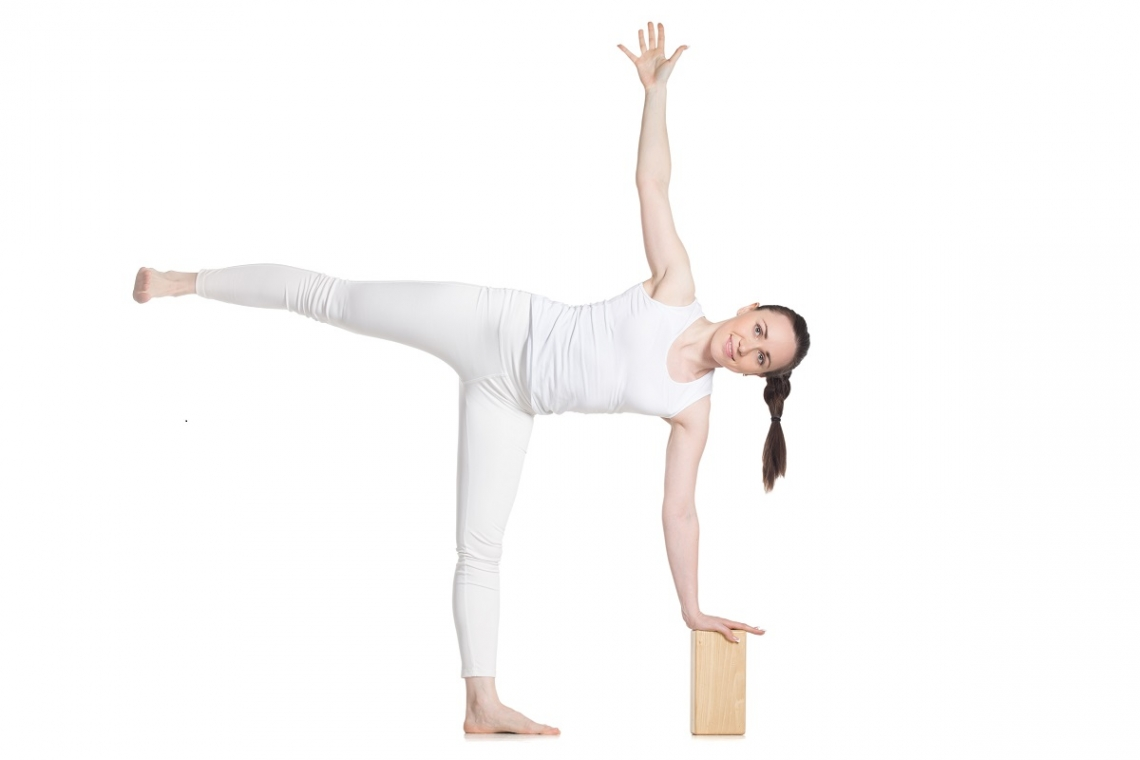 Woman in yoga half moon pose