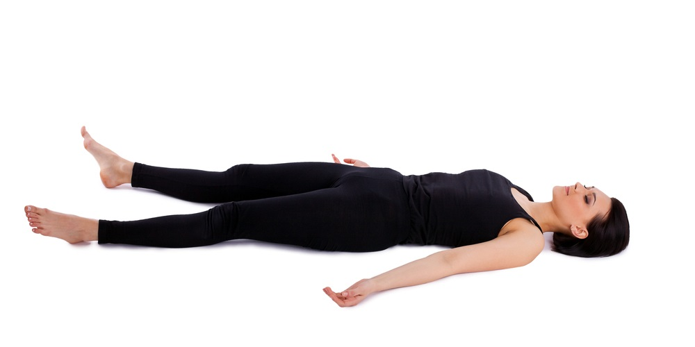 Woman in savasana yoga pose