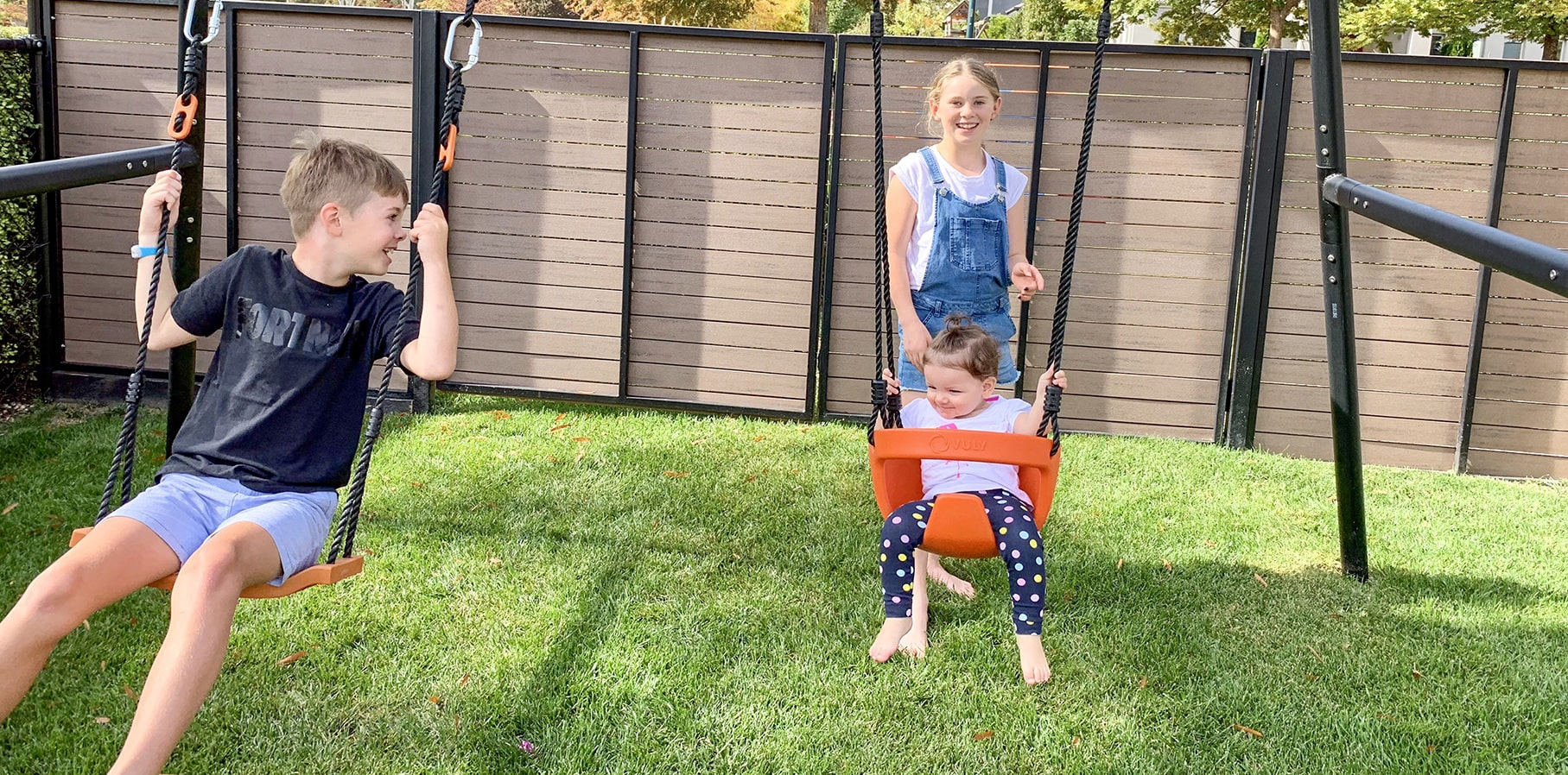 Two kids on Vuly 360 Pro Swing Set