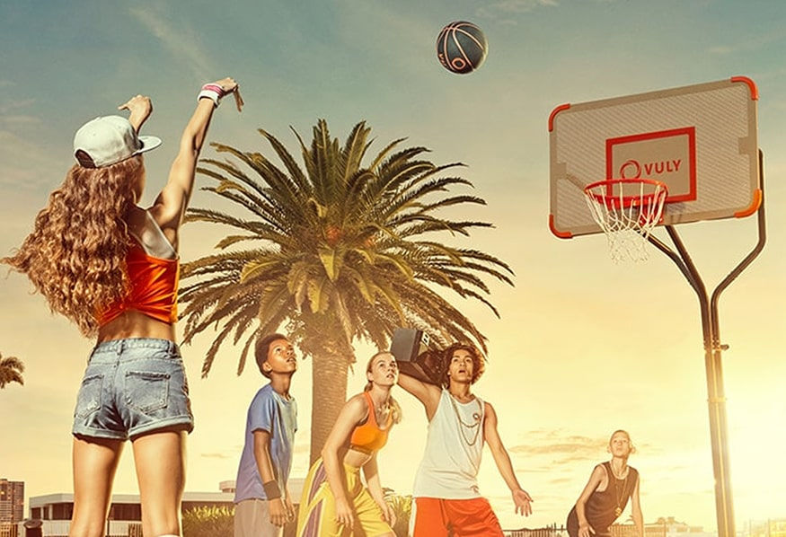 Kids playing basketball outdoors on a Vuly Slam Pro