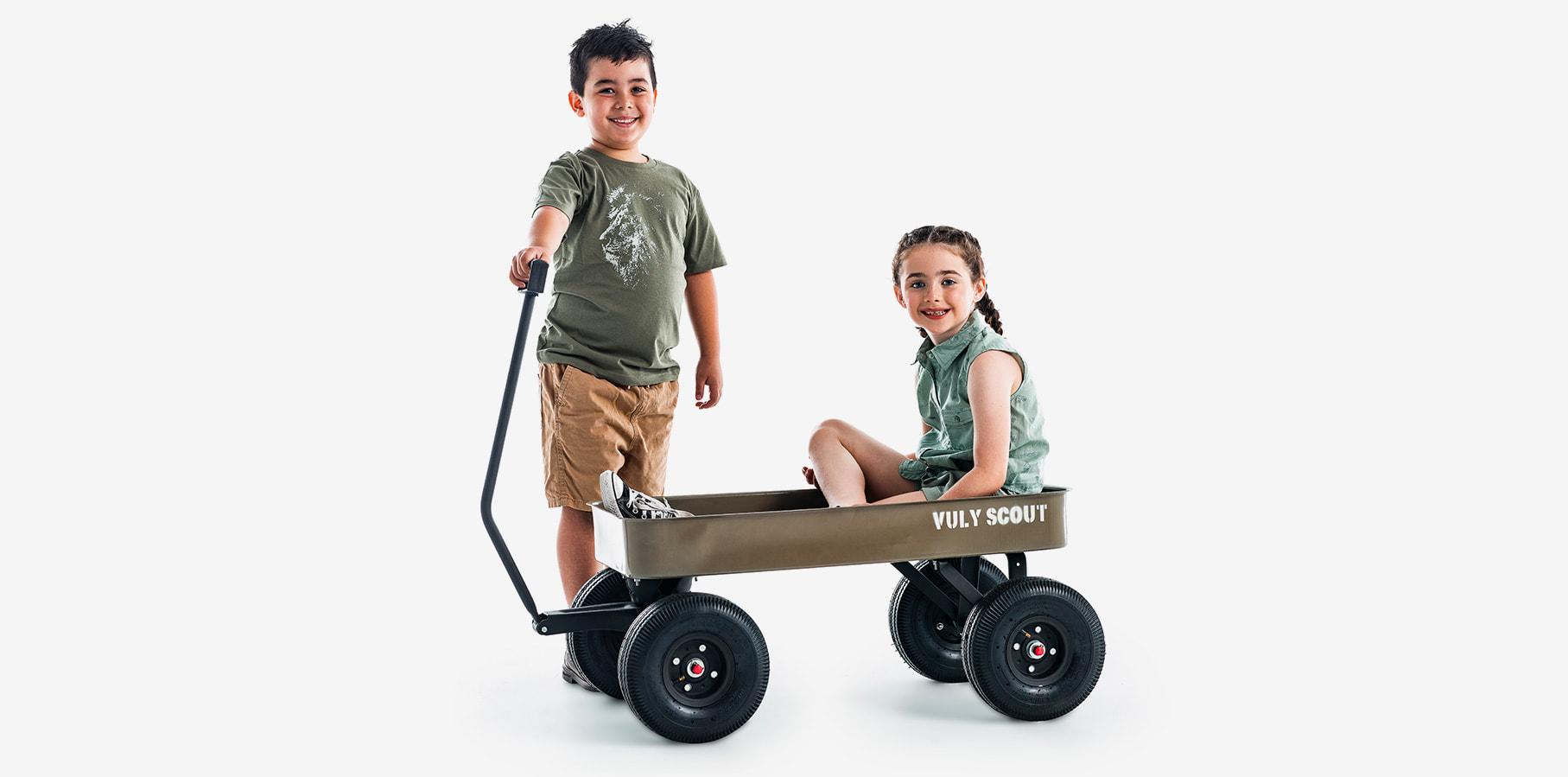 Kids riding Scout wagon